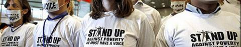 Woman wearing a Stand Up Against Poverty tee shirt
